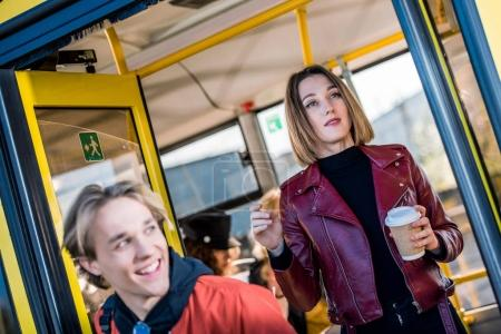 young people in city bus
