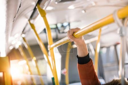person standing in bus