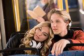 """Постер, картина, фотообои """"Молодая пара в автобусе"""""""