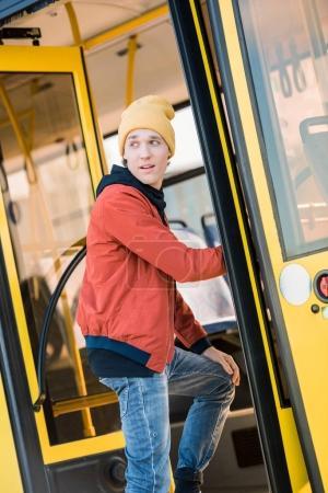man entering bus