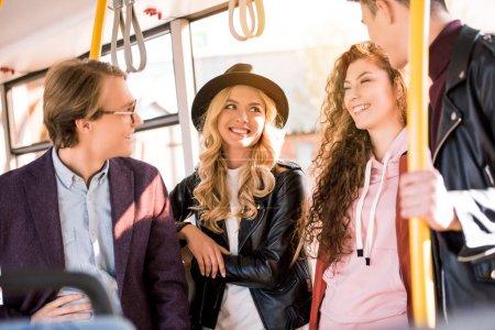friends talking in bus