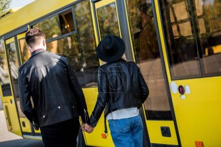 couple entering bus