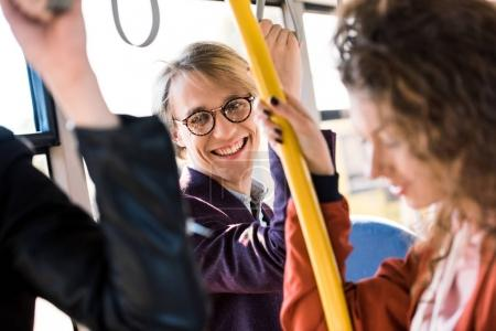 happy young man in bus