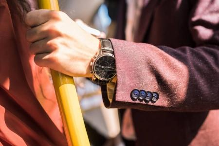 man with wristwatch in bus