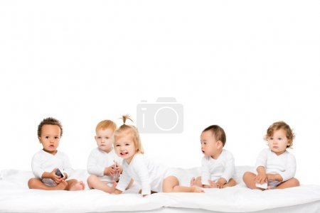 Photo for Cute multicultural toddlers holding smartphones isolated on white - Royalty Free Image
