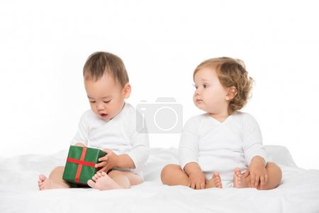 multiethnic toddlers with wrapped gift