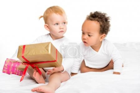 Photo for Cute multiethnic toddlers with wrapped gifts isolated on white - Royalty Free Image