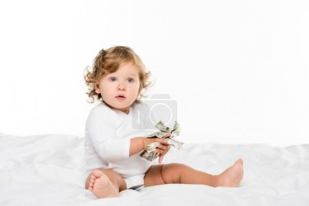 toddler holding money