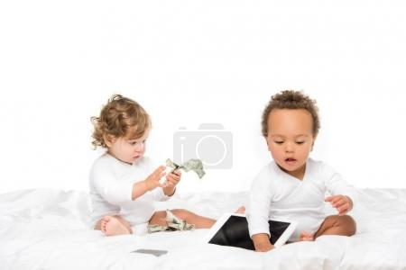 Photo for Multicultural toddlers with cash and digital tablet isolated on white - Royalty Free Image