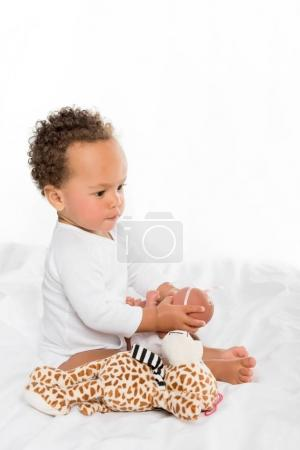 african american toddler with toys