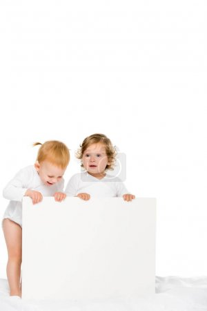 Photo for Cute toddlers holding empty banner isolated on white - Royalty Free Image