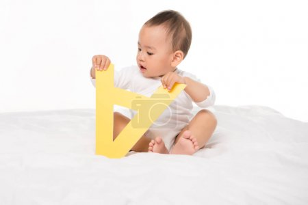 asian toddler boy with paper letter