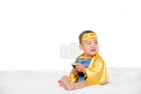 asian toddler with smartphone