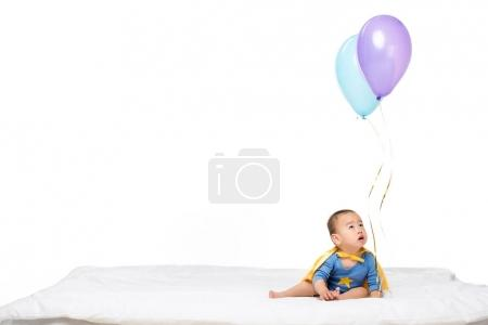 asian toddler with balloons