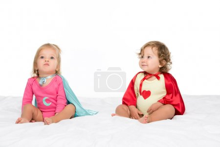 Photo for Portrait of pretty toddler girls in superhero capes isolated on white - Royalty Free Image