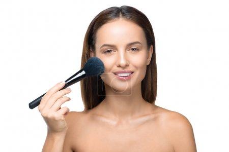 naked girl with makeup brush