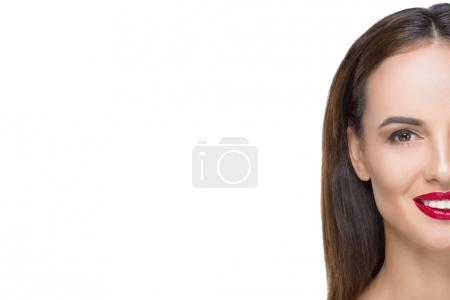 Photo for Half face portrait of beautiful young woman smiling at camera isolated on white - Royalty Free Image