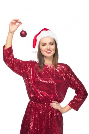 girl in santa hat with bauble
