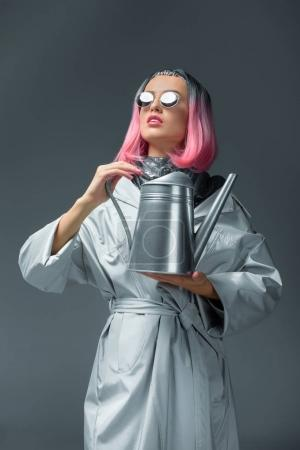 fashionable girl with watering can