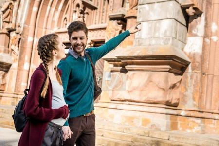 man showing architecture to wife
