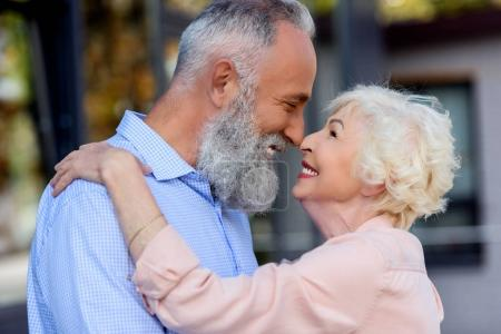 Photo for Side view of senior man and woman looking at each other on street - Royalty Free Image