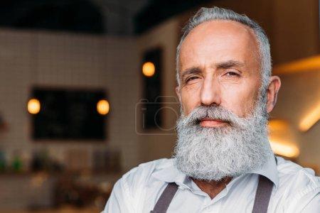 senior coffee shop worker