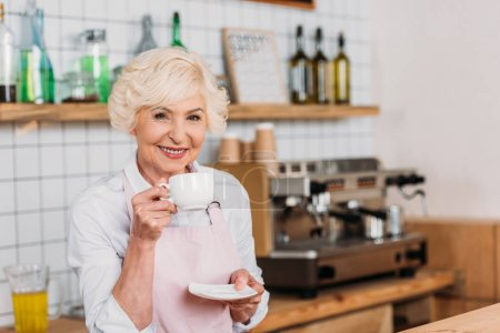 cafe worker with cup of coffee
