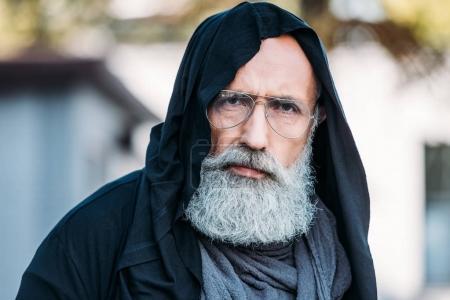 Photo for Senior bearded man in fashionable clothing and eyeglasses posing on street - Royalty Free Image