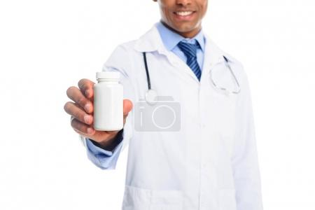 doctor with pill bottle