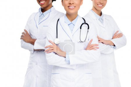Photo for Cropped view of female doctors with stethoscope and crossed arms, isolated on white - Royalty Free Image
