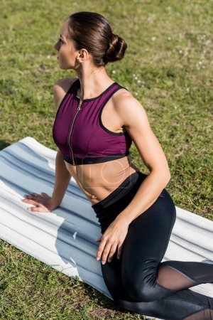 athletic woman sitting on yoga