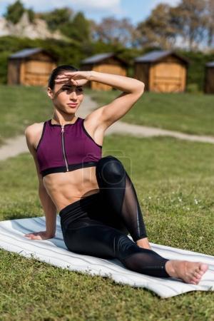 athletic woman sitting on yoga