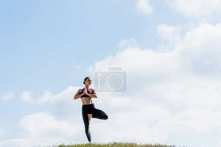 woman in tree pose