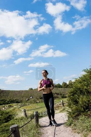 woman jogging on rural road