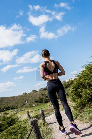 woman jogging on rural road