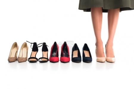 woman and arranged fashionable shoes