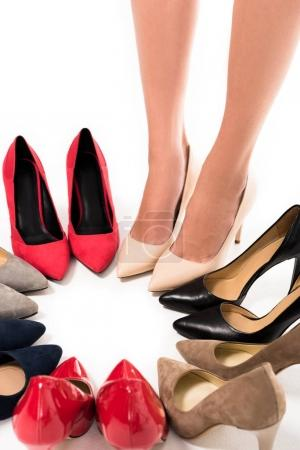 woman standing in circle with shoes