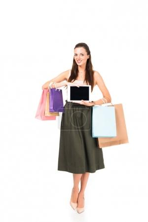 woman with shopping bags and tablet