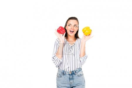 Photo for Portrait of emotional woman with tasty peppers in hands looking away isolated on white - Royalty Free Image