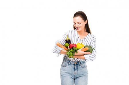 Photo for Portrait of smiling woman with various fresh vegetables isolated on white - Royalty Free Image