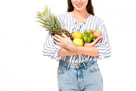 woman holding various fruits