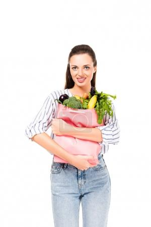 woman holding shopping bag with food