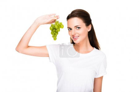 smiling woman with fresh grapes