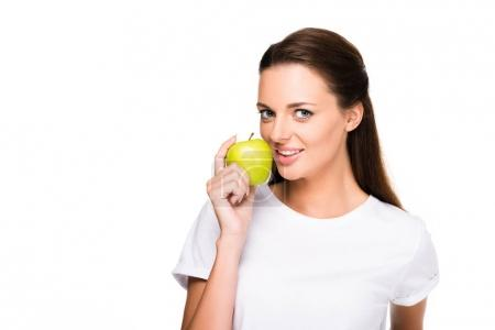 Photo for Portrait of beautiful woman with fresh apple in hand looking at camera isolated on white - Royalty Free Image