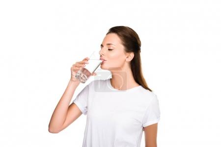 Photo for Portrait of young woman drinking water from glass isolated on white - Royalty Free Image