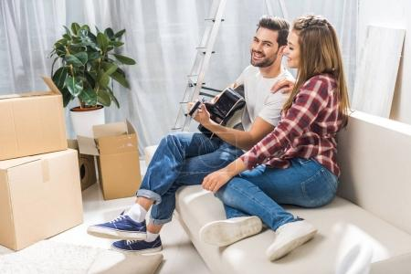 Couple on sofa with guitar