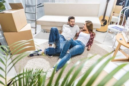 couple relaxing on floor