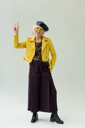 Senior woman with victory sign