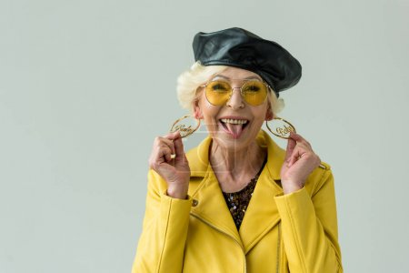 stylish senior woman in earrings