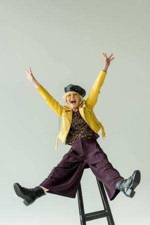 excited stylish senior woman